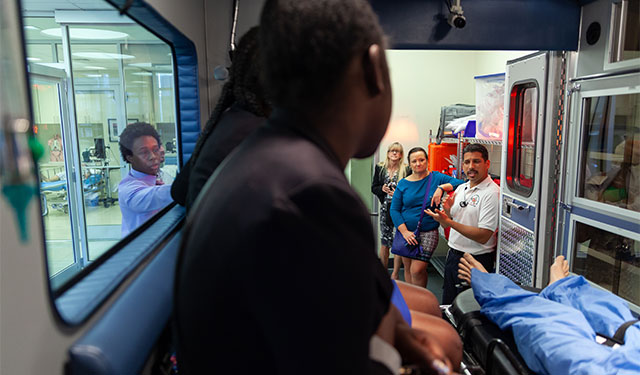 Participants in Big Brothers Big Sisters School to Work program touring the Gordon Center paramedic training facility at medical campus.