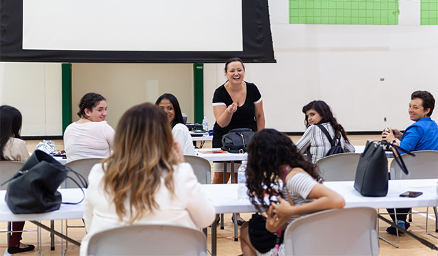 Aniette Lauredo, UM inclusion programs manager, leads a Big Brothers Big Sisters School to Work session at the Herbert Wellness Center on the Gables campus.