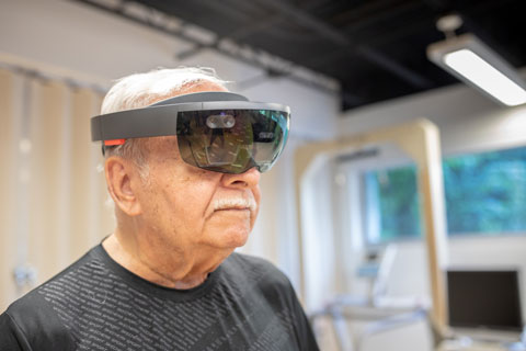 A Parkinsons patient tests virtual reality in the School of Education and Human Development