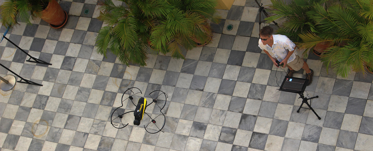 Operated by Chris Mader, the drone flies in the courtyard, taking thousands of photos stripped of perspective.