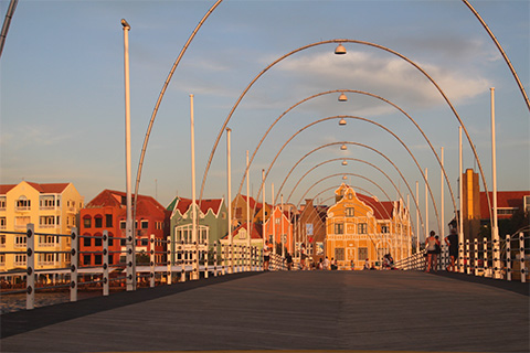 Curacao's waterfront it known for its colorful Dutch-style buildings and its floating bridge.