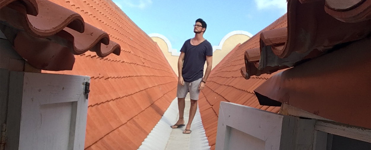 Hector Valdivia Arrieta walks the rooftop while exploring the attics.