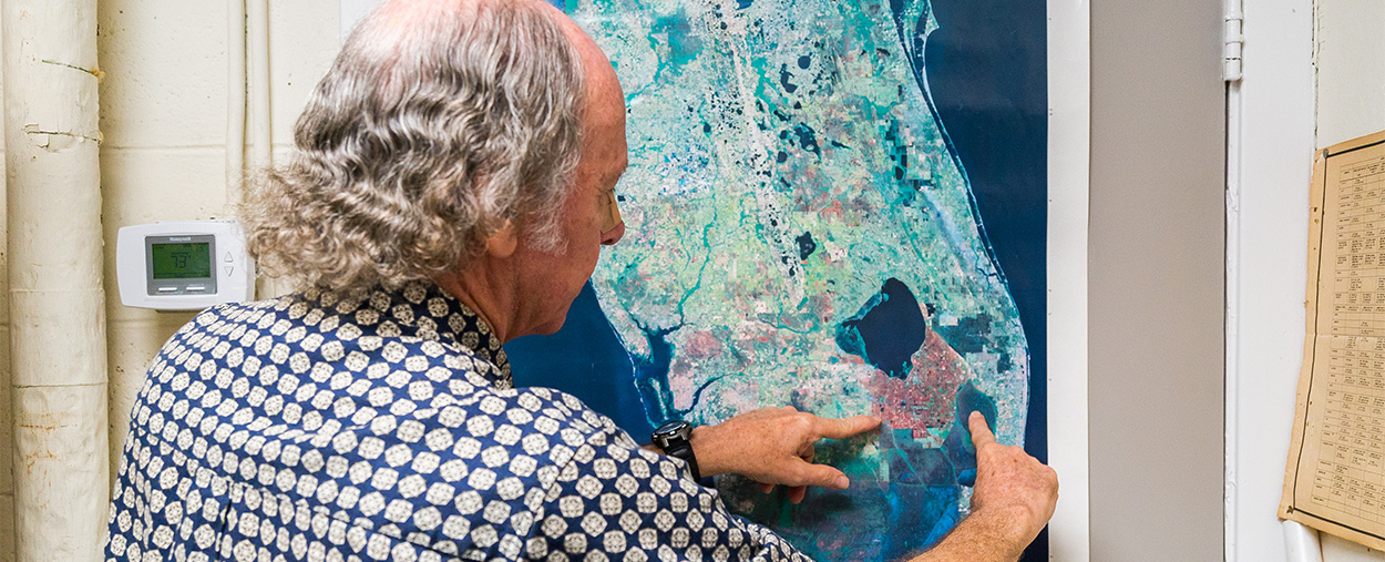 Larry Brand looking at map of Florida